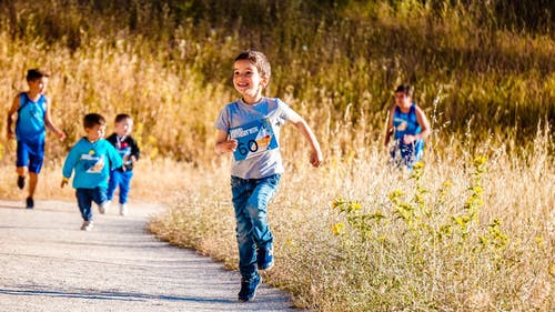 Camping with Kids running and playing outdoors